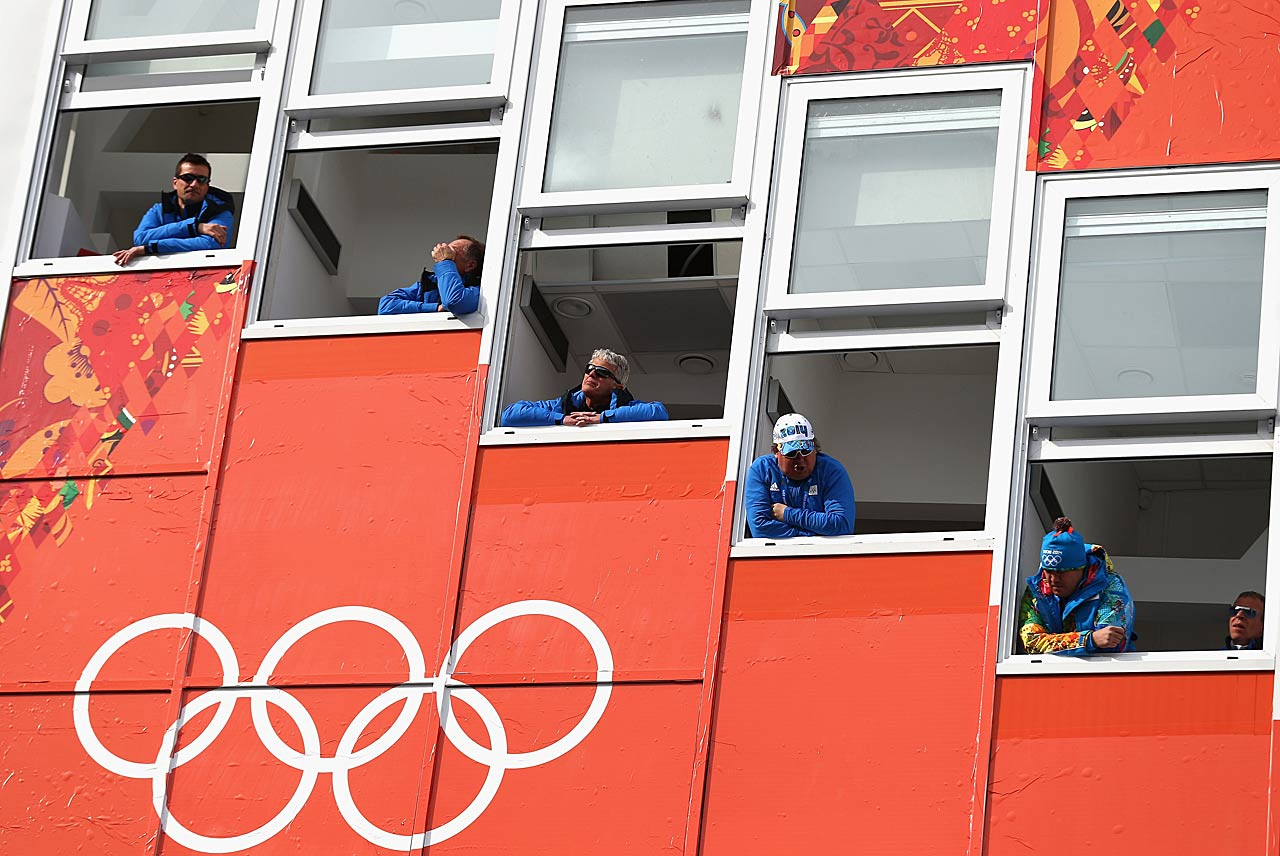 Judges look on during the Ladies' Normal Hill Individual Ski Jumping training on day 2 of the Sochi 2014 Winter Olympics .