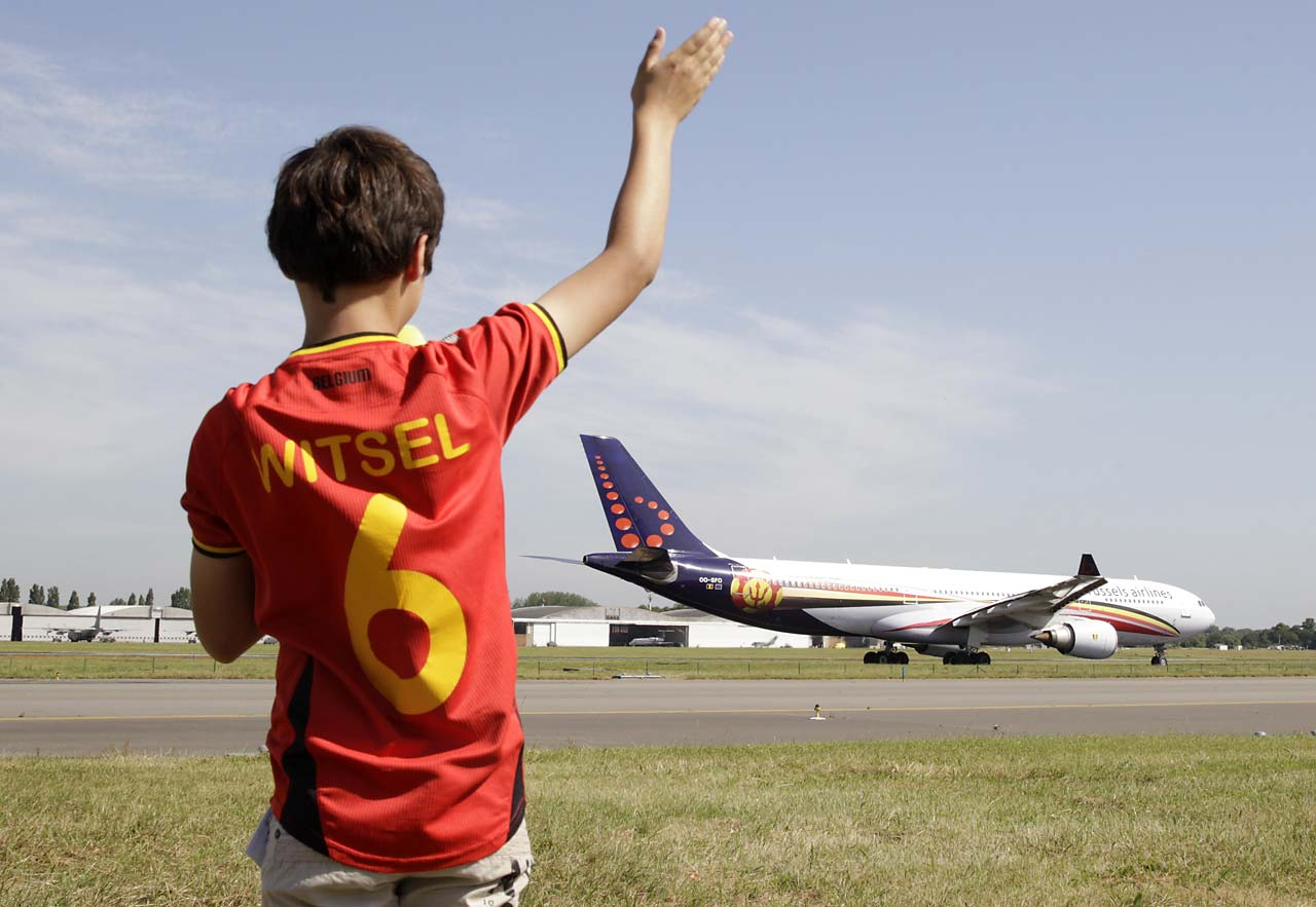 A young soccer fan waves to the plane carrying the Belgian soccer team, departing from Brussels airport to Sao Paulo on June 10.