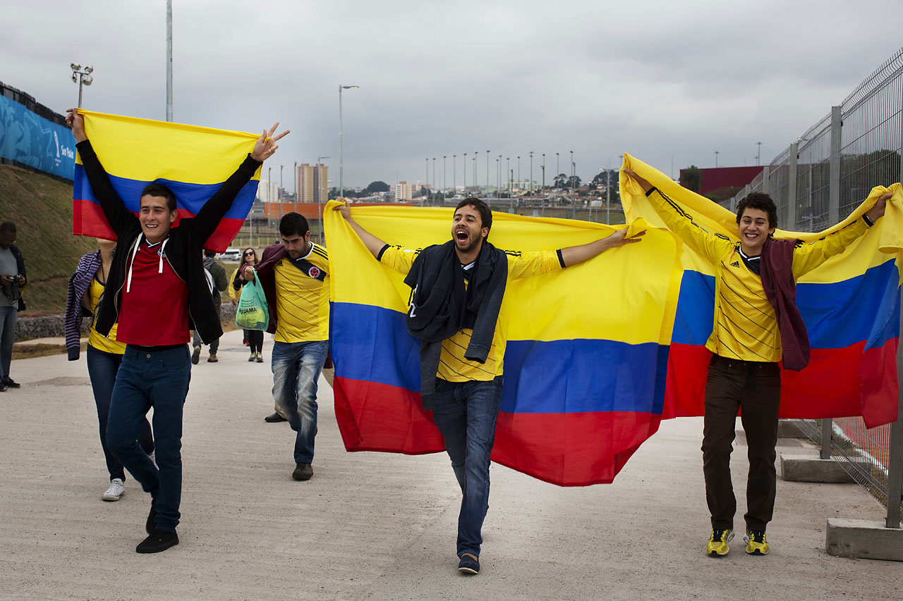 Colombia soccers fans chant slogans with their nation's flag outside Arena Corinthians stadium in Sao Paulo, Brazil on June 11.