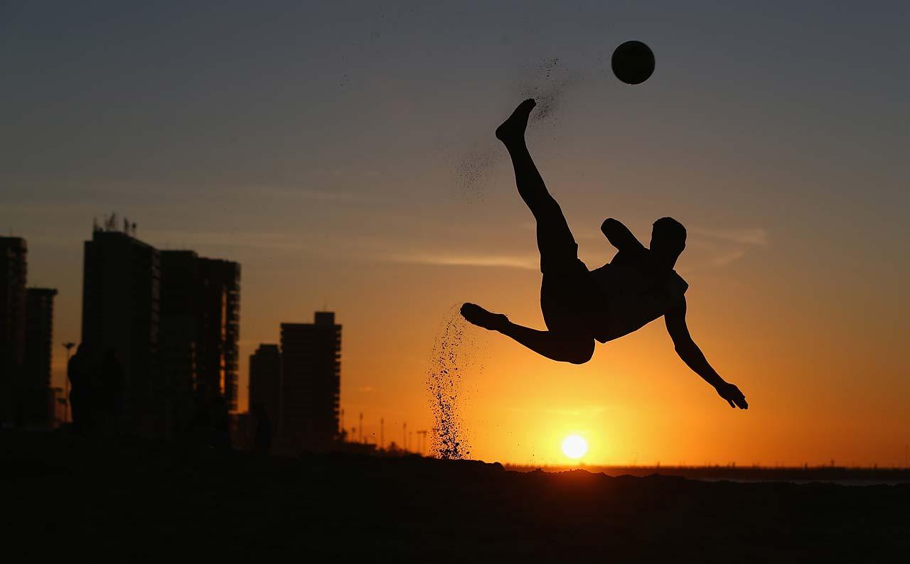 A local boy shows off his beach football skills on Magna Praia beach on June 11 in Fortaleza, Brazil.