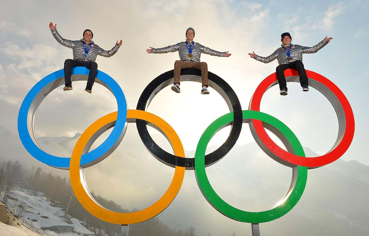 Gold medalist Joss Christensen (center), silver medalist Gus Kenworthy (left) and bronze medalist Nicholas Goepper pose for a photo shoot.  They became only the third U.S. trio to sweep the podium at a Winter Olympic event.