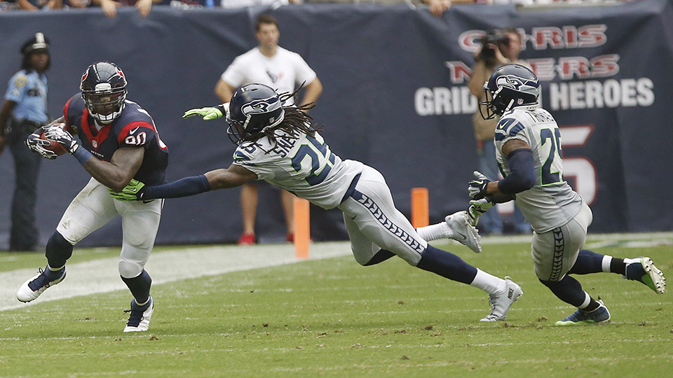 Seahawks cornerback Richard Sherman reaches out to tackle Texans WR Andre Johnson at Reliant Stadium in 2013.