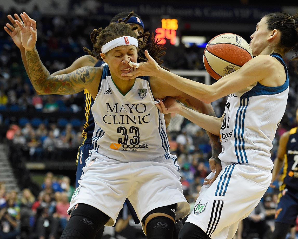 Seimone Augustus, left, and Anna Cruz collide in game 2 of the WNBA Finals.