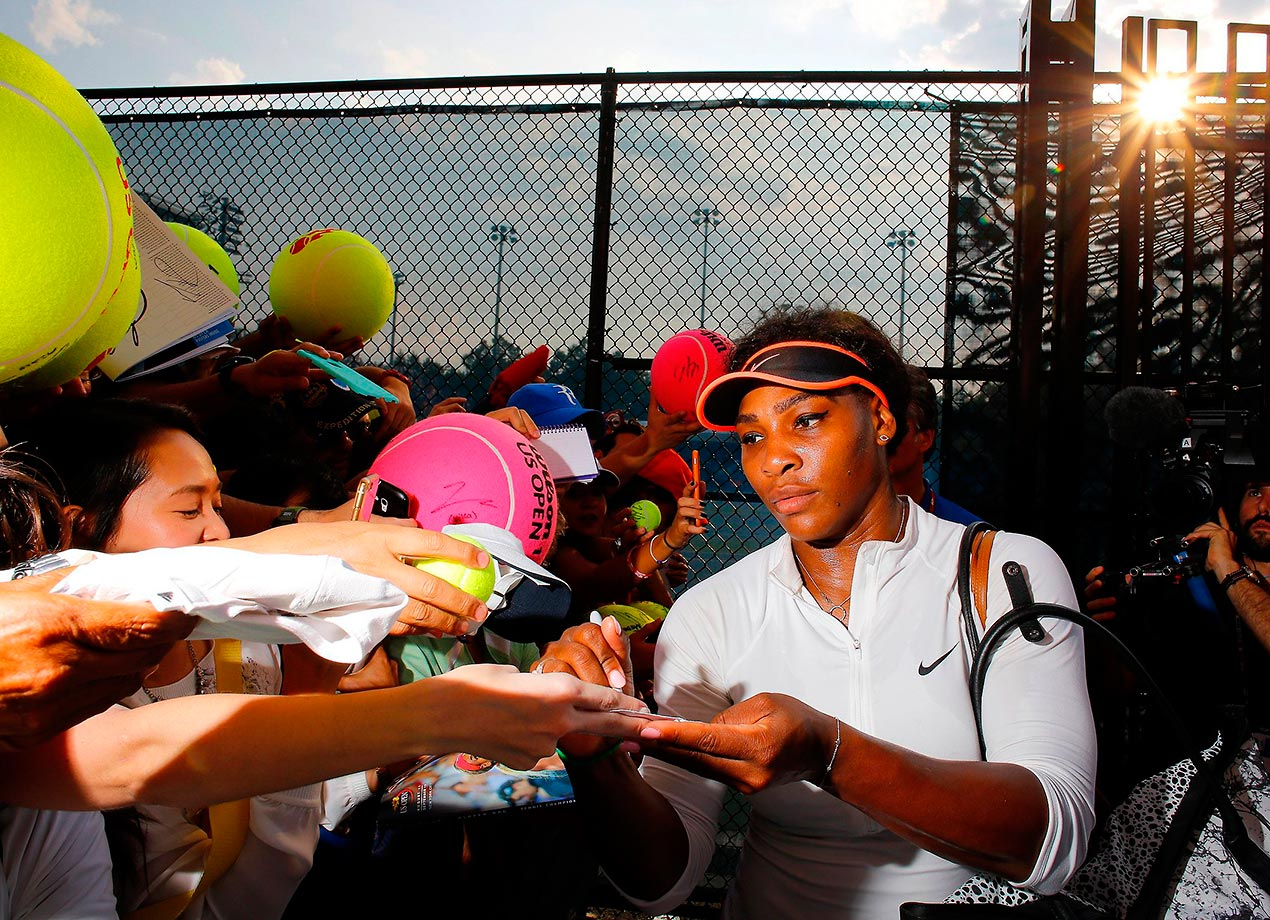 Serena signing autographs for fans at the 2015 U.S. Open.