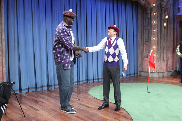 Shaquille O'Neal and Jimmy Fallon shake hands after a heated game of mini-golf. (Getty Images)