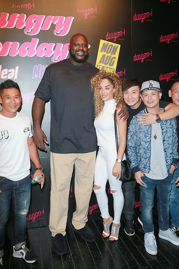 Shaquille O'Neal, actor Alex Fong and singer Justin Lo pose during O'Neal's tour in Hong Kong.