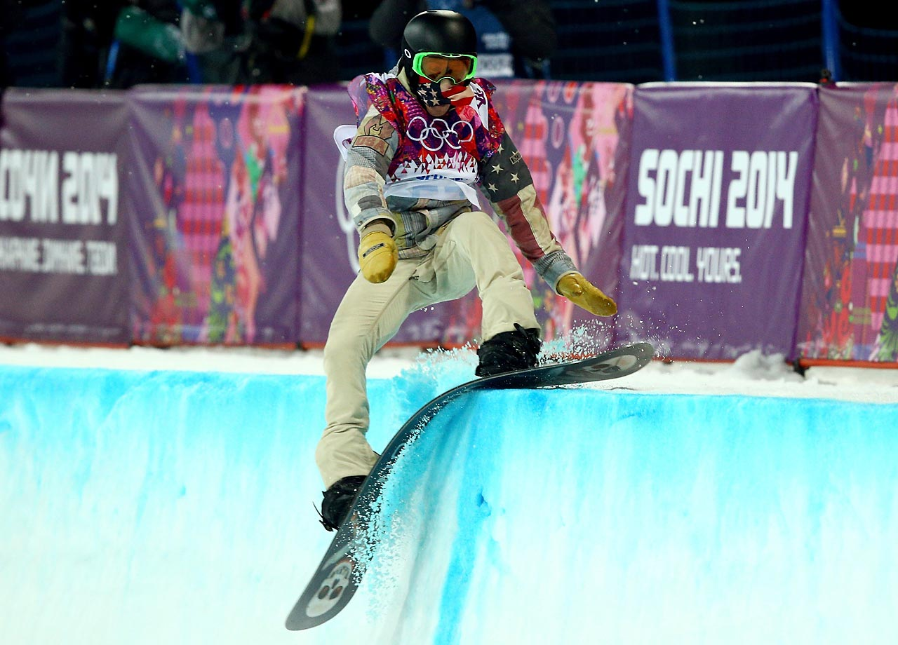 White hits the edge of the halfpipe during the final.