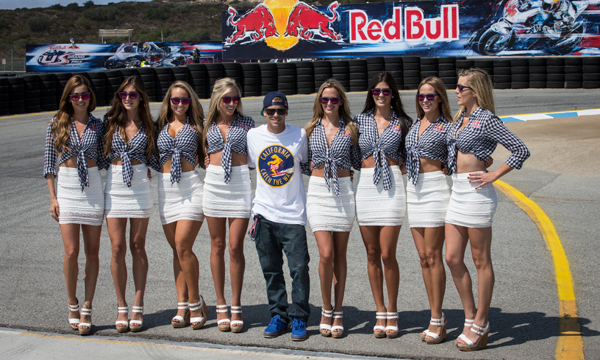 Living the life, Sheckler has had plenty of photo opportunities in his time, seen here posing with the grid girls at the MotoGP qualifier of the Red Bull U.S. Grand Prix last year.