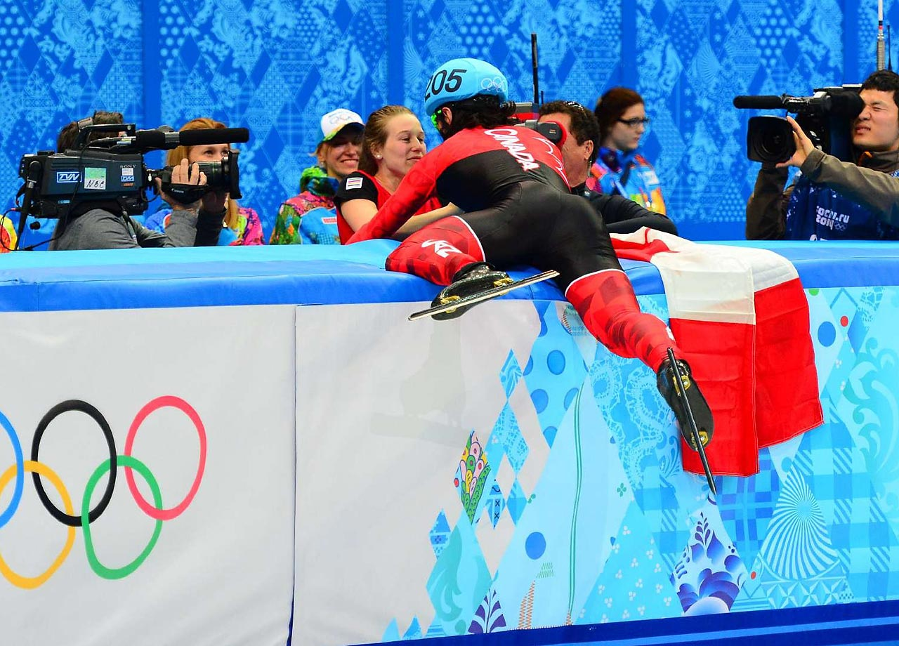 Hamelin embraces his girlfriend Marianne St-Gelais after winning the gold on Monday.