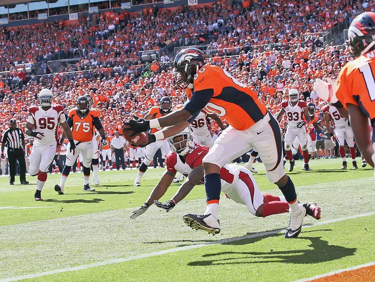 Broncos tight end Julius Thomas catches Peyton Manning's 500th career touchdown pass against Cardinals safety Tony Jefferson in the first quarter of the Broncos' 41-20 win.