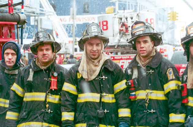 Jimmy barely escaped the collapsing tower, but his Engine 5 friend Manny Del Valle (center) was still missing as of Monday.