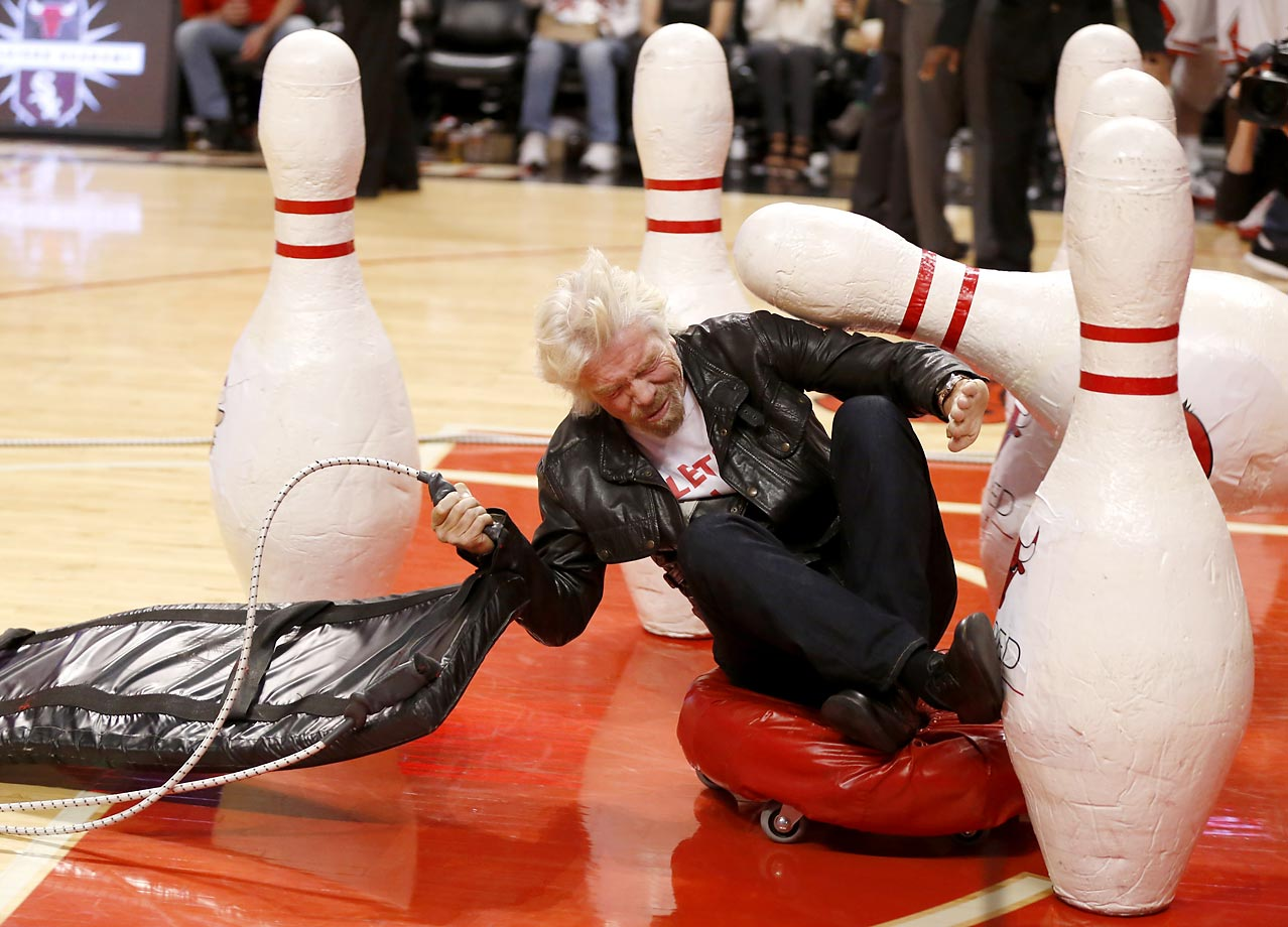 Sir Richard Branson takes part in a court stunt at the game between the Chicago Bulls and the Atlanta Hawks.