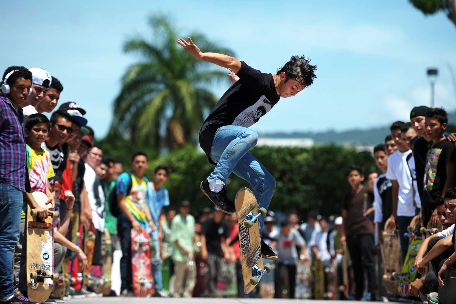 A skateboarder pops tricks in the streets of San Salvador, El Salvador.