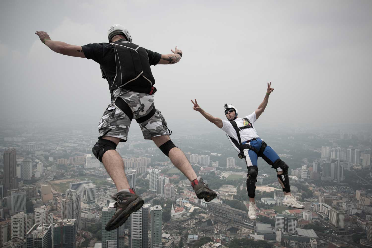 Base jumpers leap from the Open Deck of the Kuala Lumpur Tower in Malaysia.