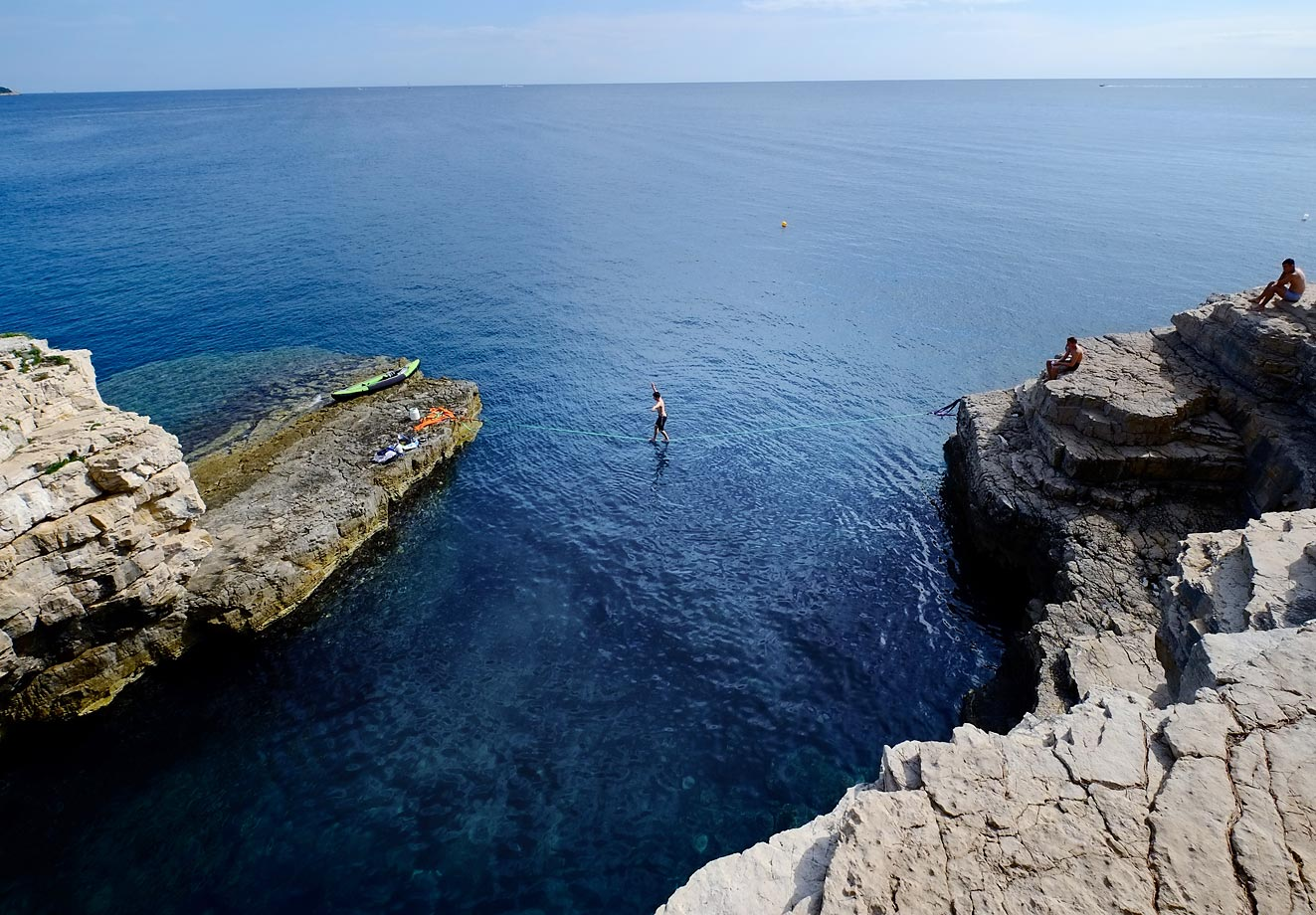 A climber walks over a 'Slackline' at the cliffs of Stoja on Aug. 5, 2014, near Pula, Croatia.