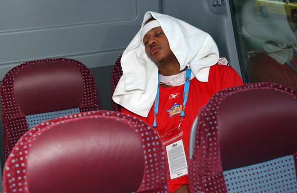 Carmelo Anthony sleeps on the bus on the way to the Sophomore Team Practice during NBA All-Star Weekend in February 2005.