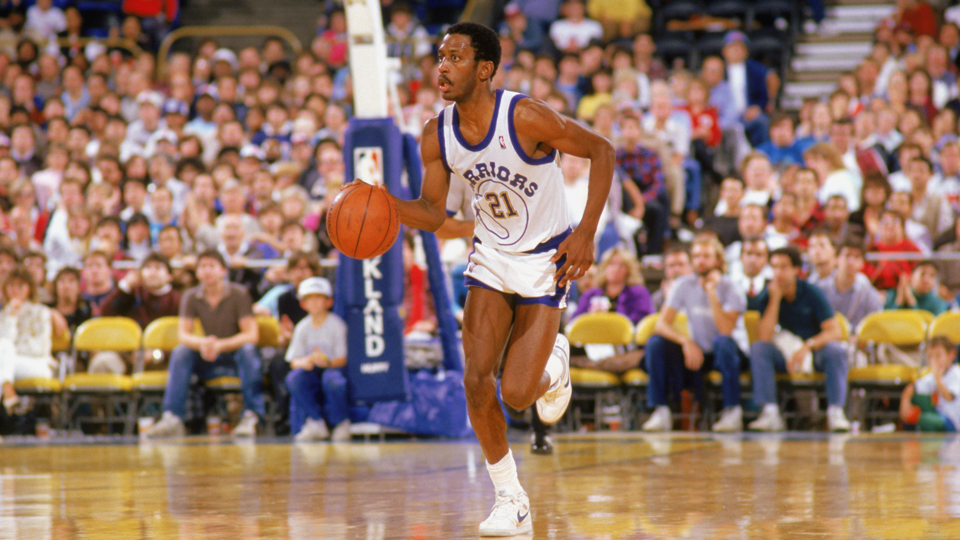 Golden State Warriors guard Sleepy Floyd drives up the court during an NBA game in the 1988-89 season.