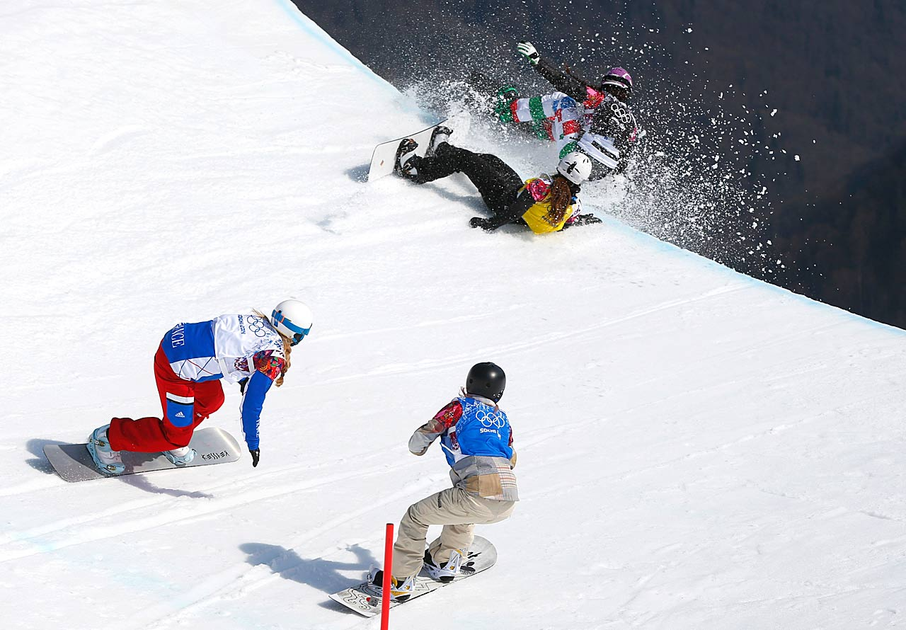 Italy's Michela Moioli, top right, and Bulgaria's Alexandra Jekova crash off a drop, as France's Chloe Trespeuch, left, and Faye Gulini of the United States follow during the women's snowboard cross final.