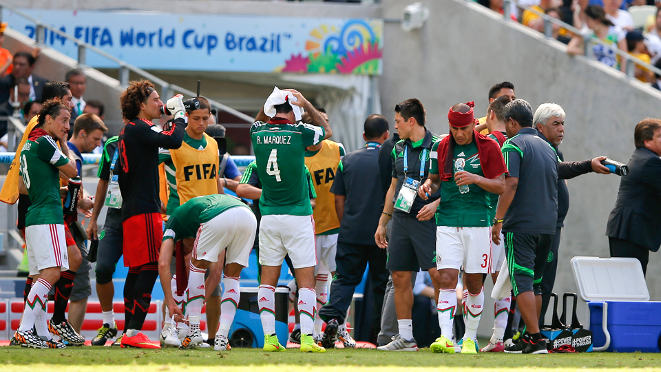 Mexico players take a cooling break during the World Cup round of 16 soccer match between the Netherlands and Mexico at the Arena Castelao in Fortaleza, Brazil, Sunday, June 29, 2014.