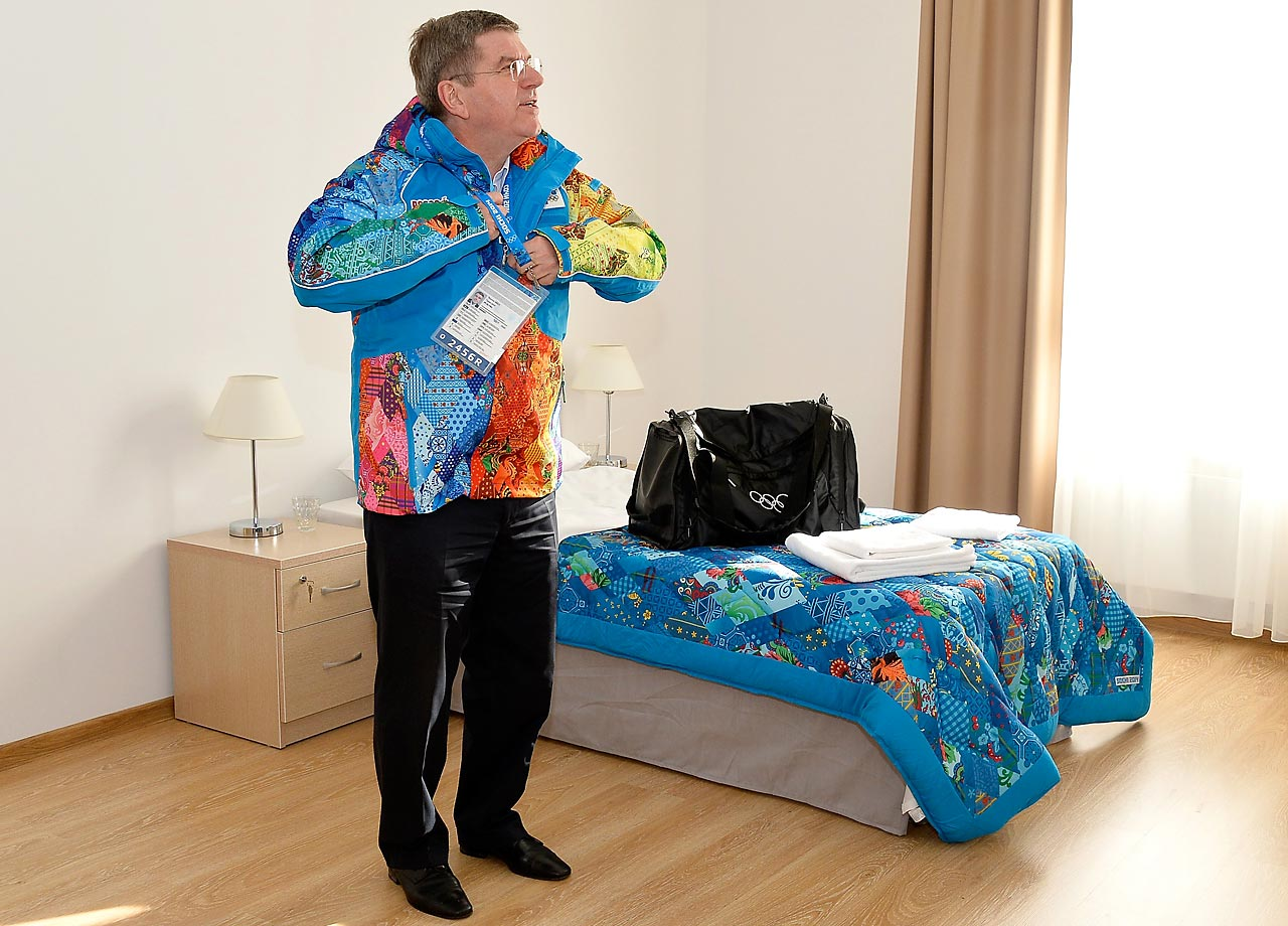 IOC President Thomas Bach looks on in his room in the Athletes Olympic Village.