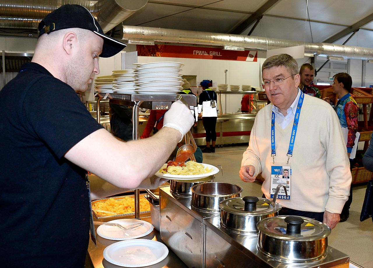 International Olympic Committee President Thomas Bach is served lunch in the Athletes Olympic Village.