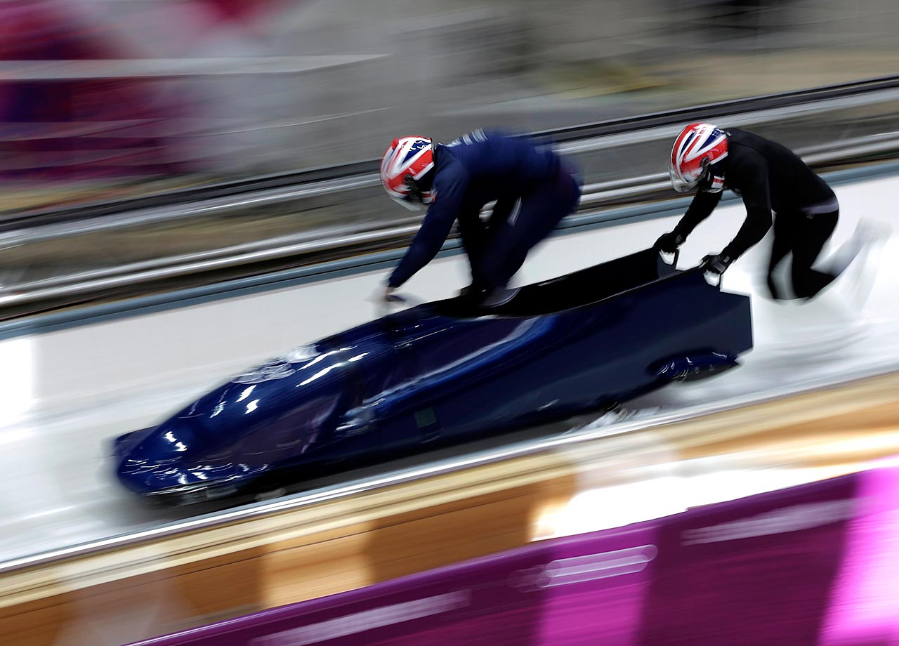 Members of the Great Britain bobsleigh team practice.