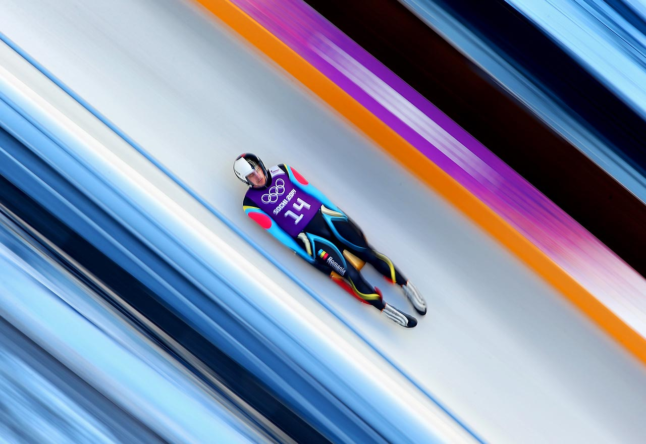 Valentin Cretu of Romania takes part in a men's luge training session.