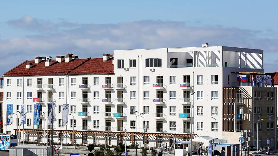 Fewer flags fly from the balconies of the athletes' village at Sochi Olympics, including no U.S. flags.