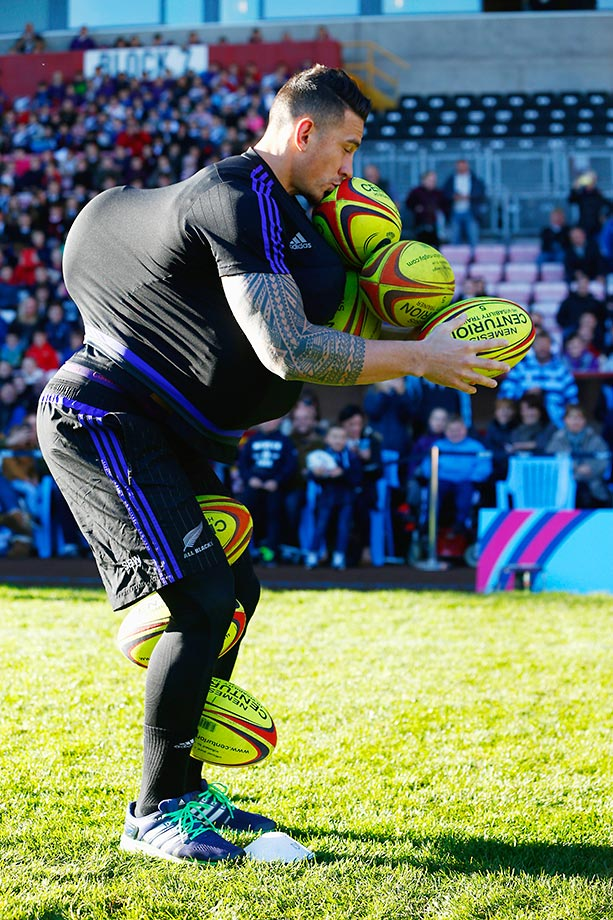 Sonny Bill Williams of the All Blacks attempts to hold as many balls as he can during a community event in the U.K.