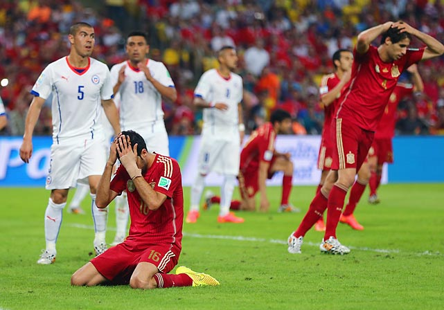 Sergio Busquets of Spain reacts after a missed chance in his team's disappointing loss to Chile. The defeat knocked the defending World Cup champions out of the running to advance to the next round.
