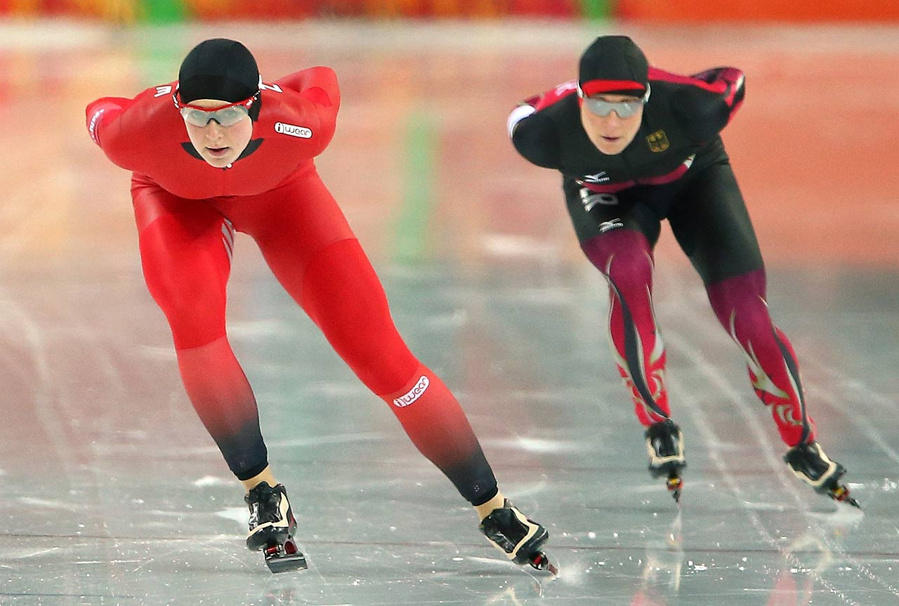 Ida Njaatun of Norway (left) and Claudia Pechstein of Germany compete during the women's 3000m Speed Skating event.
