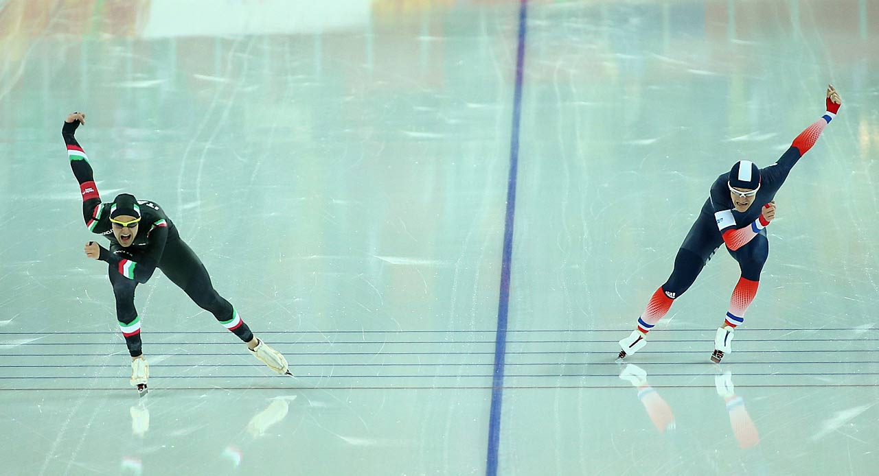 Andrea Giovannini of Italy and Ewen Fernandez of France compete during the 5000m speed skating event.