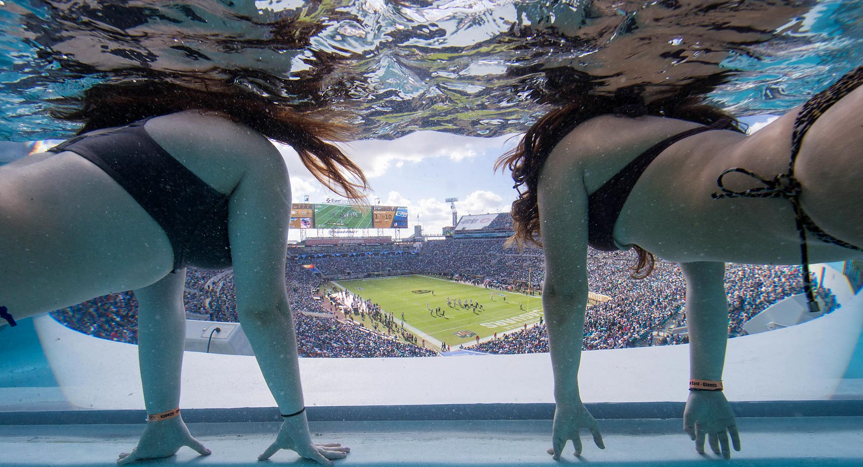 Fans watch the New York Giants vs. Jacksonville Jaguars game from underwater in the northeast pool on the Clevelander Deck at EverBank Field.