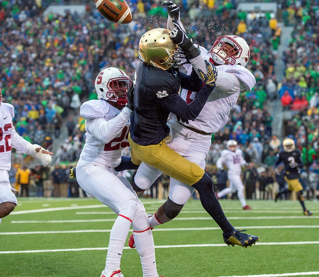 Stanford Cardinals defensive backs Alex Carter and Jordan Richards break up a pass in the end zone intended for Notre Dame wide receiver William Fuller.