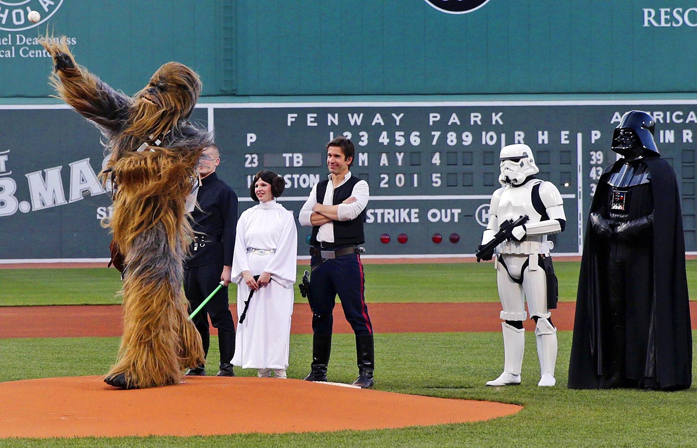 Chewbacca throws the ceremonial first pitch on Star Wars Day at a game between the Rays and Red Sox.