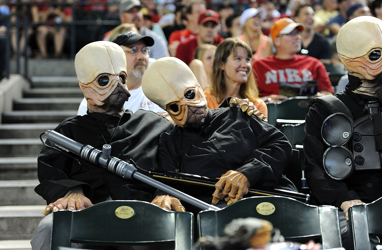 Fans dressed as members of the Star Wars Cantina Band sit in the stands during a game between the Arizona Diamondbacks and the Cincinnati Reds on June 23, 2013 at Chase Field in Phoenix, Ariz.