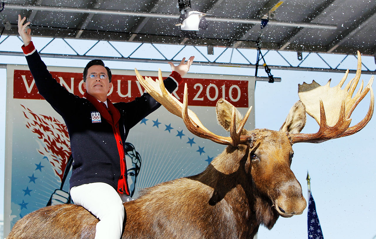 Stephen Colbert acknowledges the crowd while sitting on a stuffed moose on stage during the taping of The Colbert Report at Creekside Park on Feb. 18, 2010 in Vancouver, Canada.