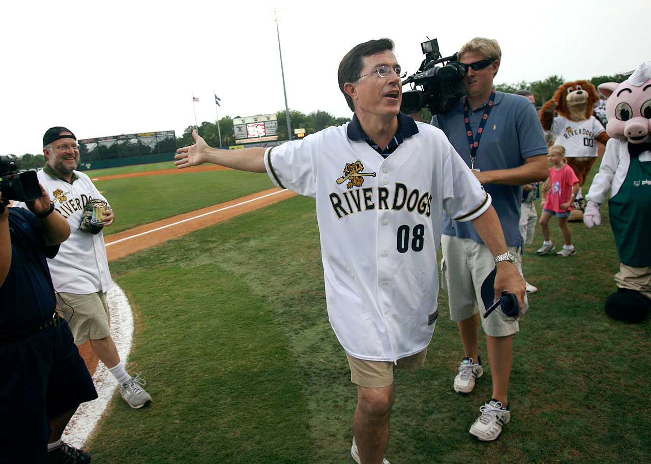 "Stephen Colbert, followed by Jerry Greenfield of Ben & Jerry's ice cream, returns to the dugout after he threw out the ceremonial ""first pint"" to Greenfield, a pint of ""Stephen Colbert's AmeriCone Dream"" ice cream, during a Charleston RiverDogs baseball game on July 7, 2007 in Charleston, S.C."