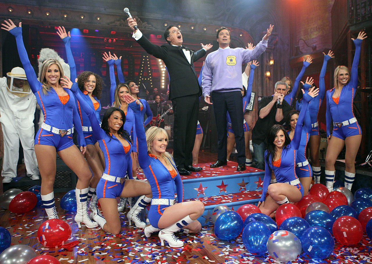 "The Knicks City Dancers surround Stephen Colbert, Jimmy Fallon and Taylor Hicks in the finale of their version of ""Friday"" by Rebecca Black while taping an episode of Late Night with Jimmy Fallon on April 1, 2011 in New York City."