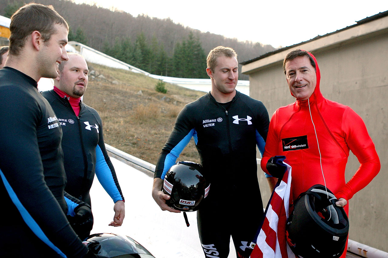 Stephen Colbert talks with Justin Olsen, Steven Holcomb and Curtis Tomasevicz after taking a ride in their bobsled while filming a segment at the FIBT Bob & Skeleton World Cup on Nov. 22, 2009 at the Olympic Sports Complex in Lake Placid, N.Y.