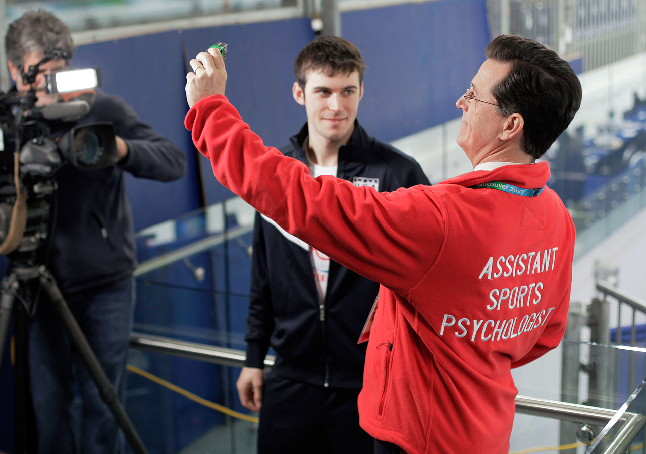 Stephen Colbert takes a selfie during an interview with U.S. speed skater Mitchell Whitmore (center) prior to the men's 1,000 meter speed skating race at the Richmond Olympic Oval on Feb. 17, 2010 during the Winter Olympics in Vancouver, Canada.
