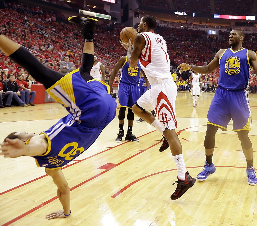 Stephen Curry topples over during Game 4 of the Western Conference finals against the Rockets.