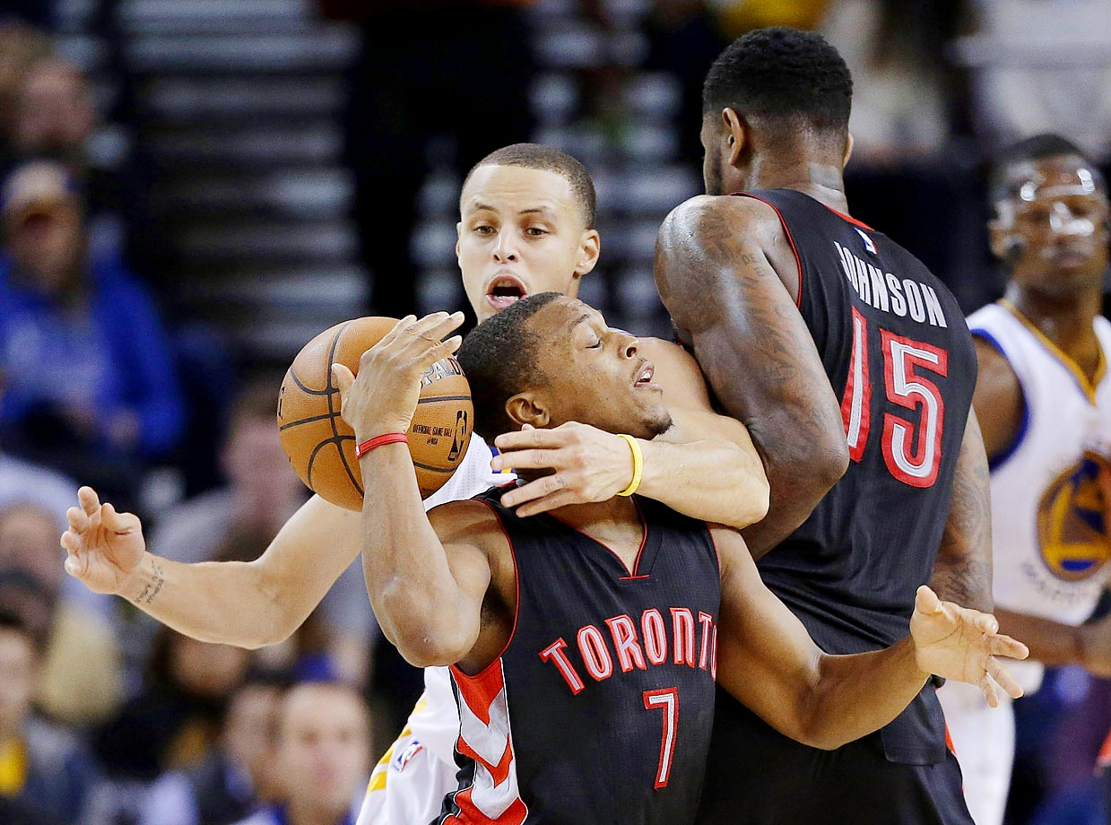Stephen Curry of the Golden State Warriors strips the ball from Toronto's Kyle Lowry. Golden State won 126-105.