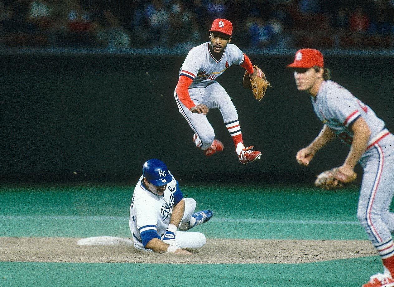 Ozzie Smith attempts to turn a double play against the Royals' Steve Balboni. The Cardinals won 4-2.