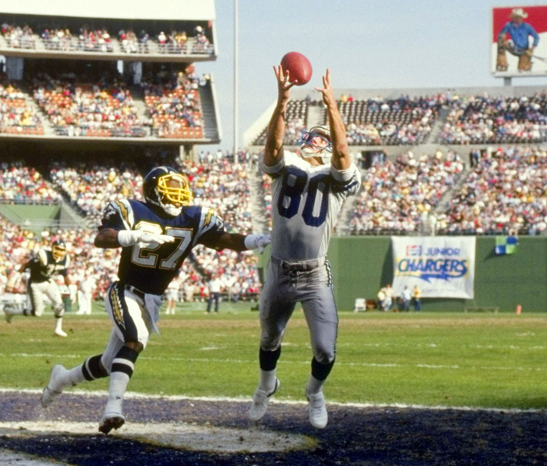 Relatively unknown coming out of college -- he was drafted by the Oilers in the fourth round before being traded to Seattle after the preseason -- Steve Largent became one of the NFL's great receivers. He caught 819 passes in his career, including 100 receiving touchdowns. Largent also racked up 13,089 receiving yards throughout his time in the NFL. When he retired in 1989, all three numbers were league records. Largent was inducted into the Pro Football Hall of Fame in 1995.