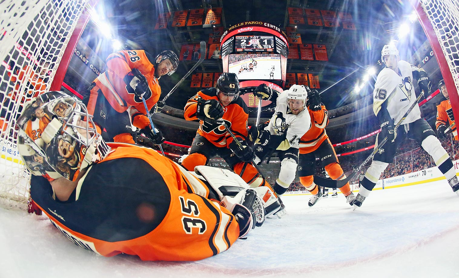 Steve Mason of the Flyers lays on the puck as teammates Carlo Colaiacovo, Brandon Manning and Zac Rinaldo try to defend against Nick Spaling and Brandon Sutter of the Penguins.
