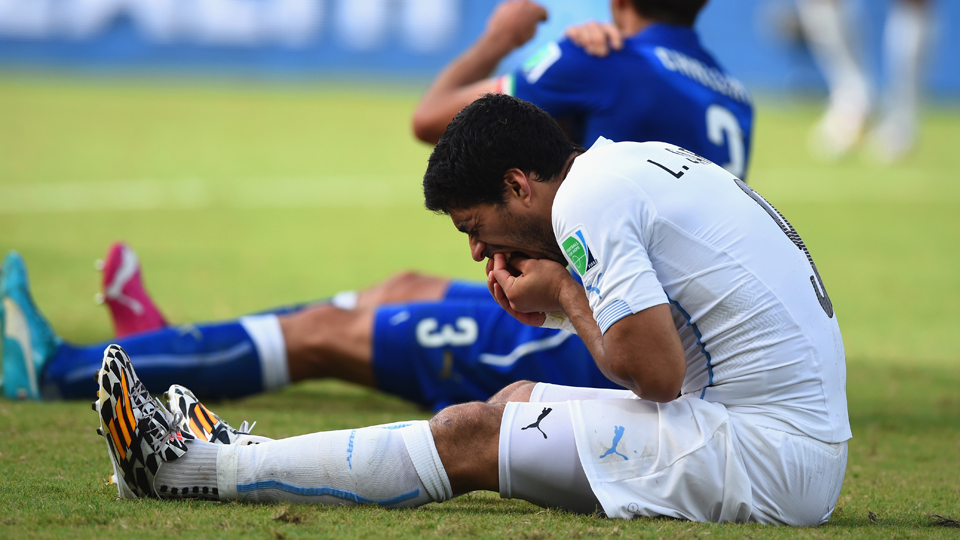 Luis Suarez and Giorgio Chiellini react after a clash during the Group D match between Italy and Uruguay at Estadio das Dunas in Natal, Brazil.