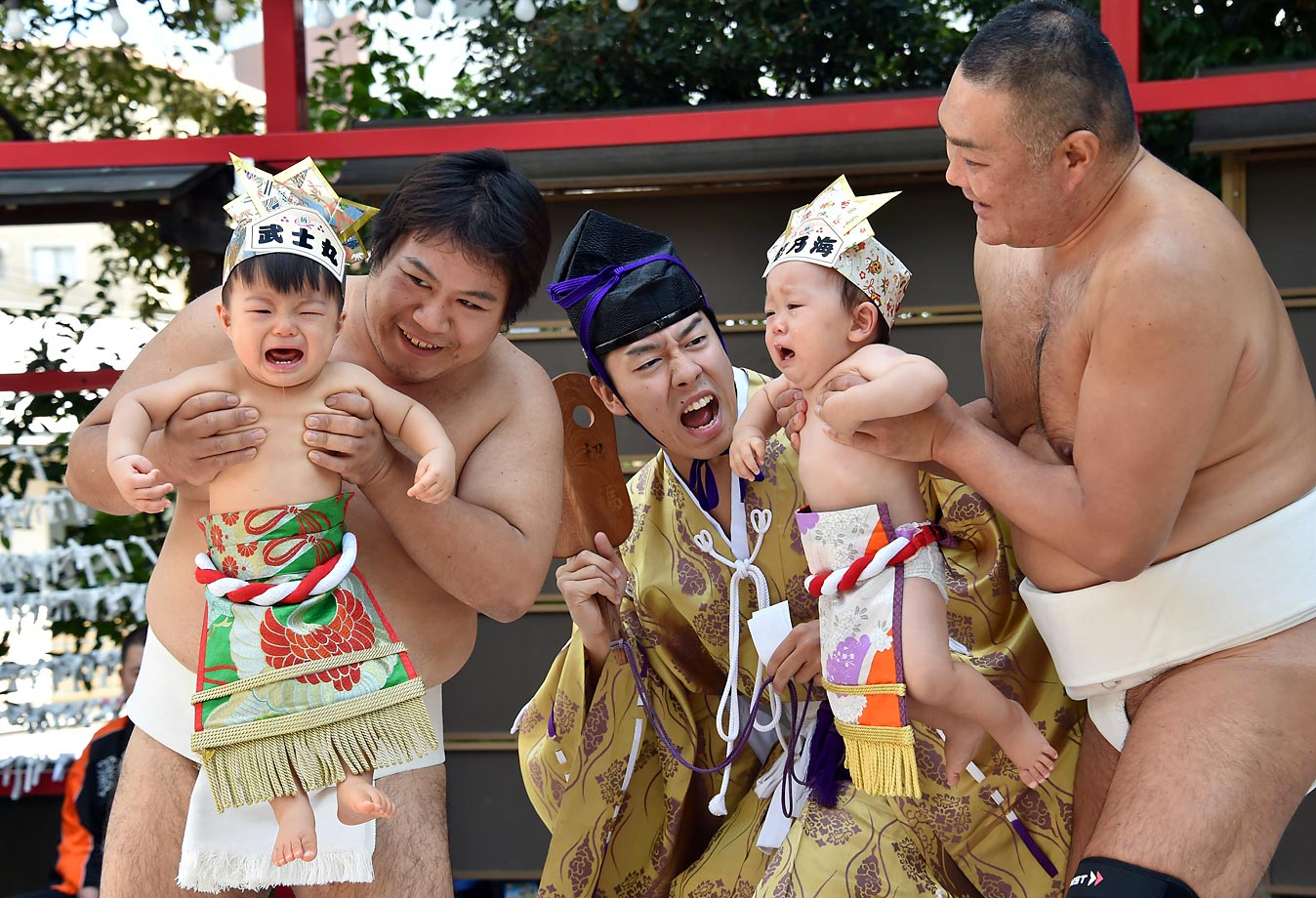 "Babies held by sumo wrestlers during the ""baby-cry sumo"" competition in Tokyo."