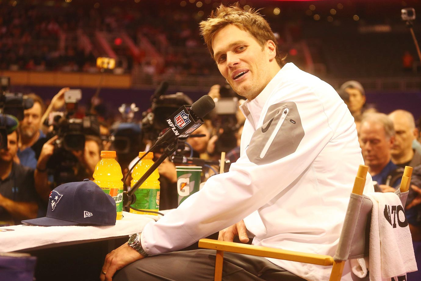 Tom Brady answers questions at media day.