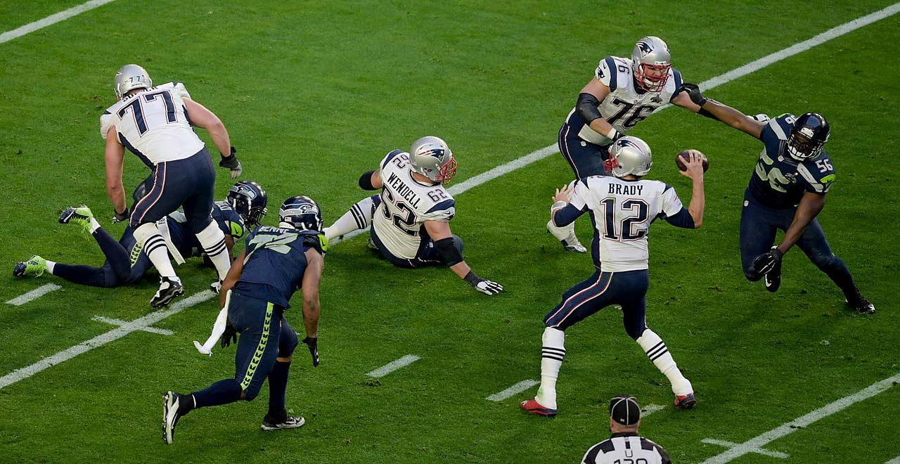 Brady gets rid of the ball before the Seattle defense can reach him.
